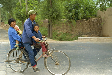 Family riding on a bicycle in Ningxia, China, Asia