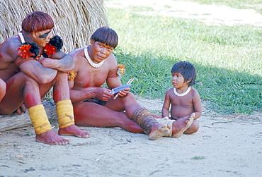 Kamayura Indian men and child, Xingu area, Brazil, South America