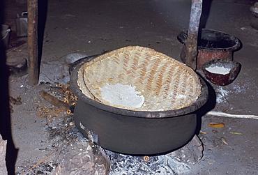 Manioc cooking over fire, Xingu area, Brazil, South America