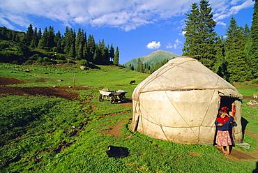 Little girl outside yurt, Altyn-Arashan near Kara-Kol, Kyrgyzstan, Central Asia