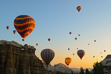 Hot air balloons cruising over Cappadocia, Anatolia, Turkey, Asia Minor, Eurasia