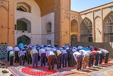 Men praying, Men's Section, Jameh Mosque, Varzaneh, Iran, Middle East