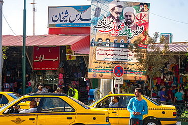 Street scene with religious poster, Qom, Iran, Middle East