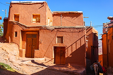 Winding lanes and donkey in 1500 year old traditional village of red mud brick houses, Abyaneh, Iran, Middle East