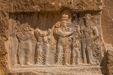 Carved relief of the Investiture of Narse, 294-302 AD, to the lower right of the Tomb of Darius the Great, Naqsh-e Rostam Necropolis, Iran, Middle East