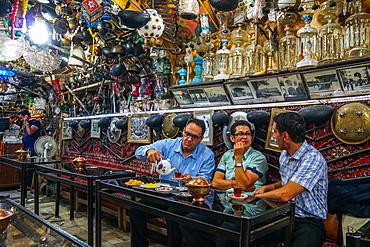 Bazaaris chatting after work, Azadegan Tea House, Isfahan, Iran, Middle East
