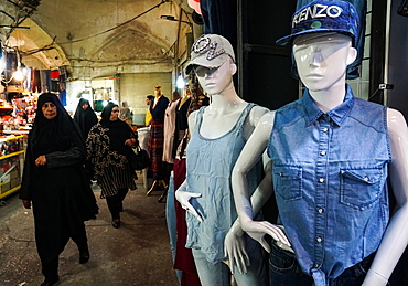 Modern dress competes with traditional dress, Grand Bazaar, Isfahan, Iran, Middle East
