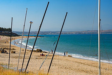 Beach seen though masts of beached boats, Mossel Bay, Western Cape, South Africa, Africa