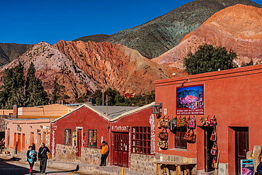 Street scene, with the Hill of Seven Colours in the background, Purmamarca, North West Argentina, South America