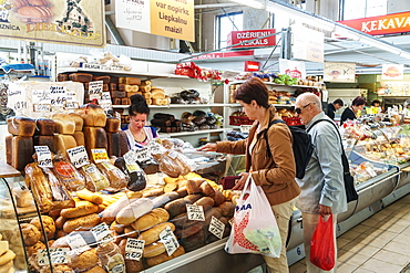 Shopping at the baker's in the covered Central Market, converted Zeppelin hangars, Riga, Latvia, Europe