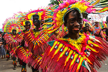 Four participants in flamboyant coloured dress marching at the annual Ati-Atihan Festival, Kalibo Island, Philippines, Southeast Asia, Asia