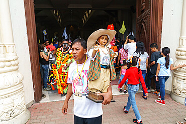 Worshipper at the door of the Cathedral with Baby Jesus statuette at the annual Ati-Atihan Festival, Kalibo Island, Philippines, Southeast Asia, Asia