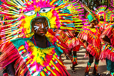Participants in flamboyant coloured dress waiting to march at the annual Ati-Atihan Festival, Kalibo Island, Philippines, Southeast Asia, Asia