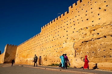 Women in traditional dress walking alongside the walls of the Kasbah Cherada in Fez Medina, UNESCO World Heritage Site, Morocco, North Africa, Africa