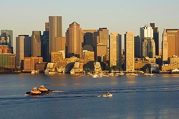 City skyline at dawn across Boston Harbor, Boston, Massachusetts, USA