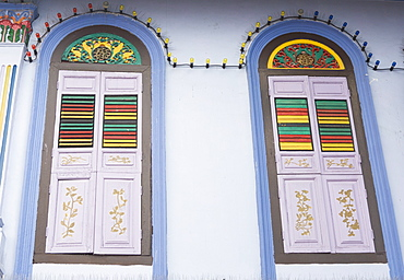 Colourfully painted window shutters in Little India, Singapore, South East Asia