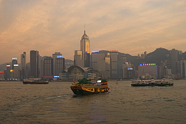 A Chinese style tourist boat sails in Victoria Harbour, Hong Kong, China, Asia