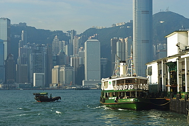 Small fishing boat and Star Ferry, Victoria Harbour, Hong Kong, China, Asia