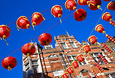 Lisle Street, Chinatown, during the Chinese New Year celebrations, decorated with colourful Chinese lanterns, Soho, London, England, United Kingdom, Europe