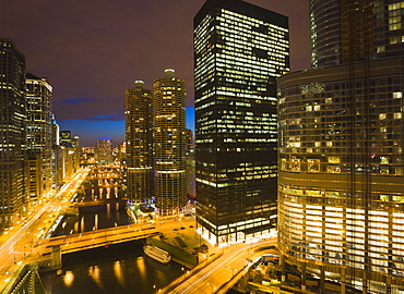 Buildings along Wacker Drive and the Chicago River at dusk, Marina City centre, Trump Tower on right, Chicago, Illinois, United States of America, North America
