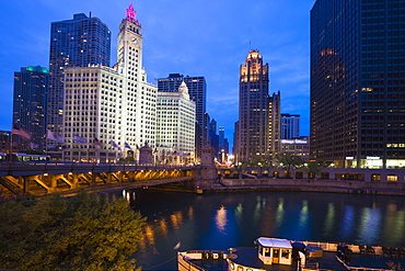 The Wrigley Building, North Michigan Avenue, and Chicago River at dusk, Chicago, Illinois, United States of America, North America