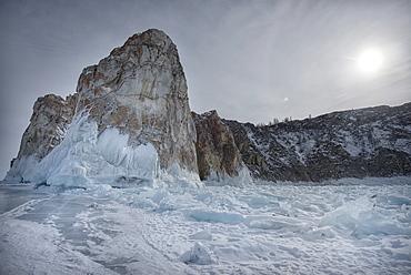 Rough ice formed at Shaman Rock, Olkhon Island as the waves freeze at the beginning of winter, Lake Baikal, Irkutsk Oblast, Siberia, Russia, Eurasia