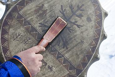 Buryat shaman Valentin Khagdaev Olkhon Island, with skin drum preparing for ceremony to celebrate the spirit of Baikal, Lake Baikal, Irkutsk Oblast, Siberia, Russia, Eurasia