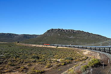 Rovos Rail train about to enter a tunnel in the Klein Karoo desert, South Africa, Africa