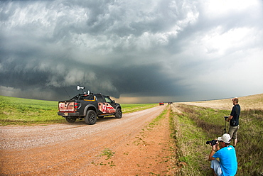 Stormchasers and TV channel nine reporting truck at scene of supercell thunderstorm near Sterling, Oklahoma, United States of America, North America