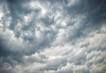 Mammatus or mammatocumulus clouds form on the underside of thunderstorms, Oklahoma, United States of America, North America