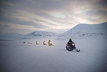 Tourists on snowmobiles (skidoos) near Barentsburg, Svalbard, Arctic, Norway, Scandinavia, Europe