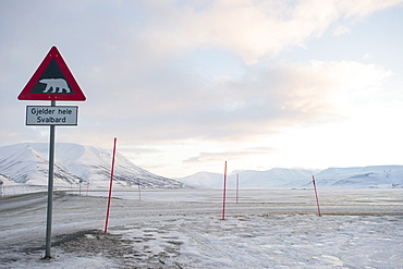 At the edge of the settlement signs warn visitors and tourists of the danger of polar bears, Svalbard, Arctic, Norway, Scandinavia, Europe