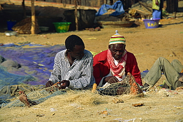 Net menders, fishing village, The Gambia, West Africa, Africa