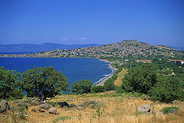 Coastline and bay with the town of Molyvos on a hill in the background, on Lesbos, North Aegean Islands, Greek Islands, Greece, Europe