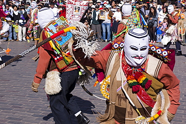 Men with whips hitting each other during the festivities of Corpus Christi, the most important religious festival in Peru, held in Cuzco, Peru, South America
