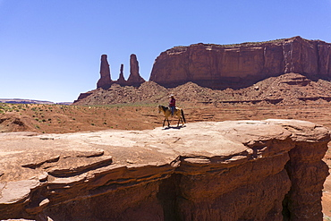 John Ford's Point and the Three Sisters and cowboy on horse, Monument Valley, border of Arizona and Utah, United States of America, North America