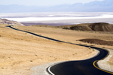 Black tarmac road, Death Valley National Park, California, United States of America, North America
