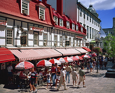 Street scene with hotel, restaurants and pavement cafes on Place d'Armes in Quebec City, Quebec, Canada, North America