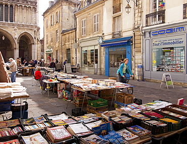 Booksellers' market stalls on Rue Musette and Church of Notre Dame, Dijon, Burgundy, France, Europe