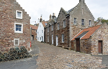A street in Crail with lobster pots, Fife Coast, Scotland, United Kingdom, Europe