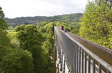 A narrow boat crossing the Pontcysyllte Aqueduct, UNESCO World Heritage Site, Llangollen Canal, Wrexham County, Wales, United Kingdom, Europe