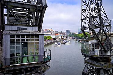 Old dockside cranes frame the harbour, Bristol, England, United Kingdom, Europe
