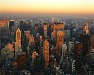 The Manhattan skyline at dusk, including the Chrysler Building, viewed from the Empire State Building, New York City, United States of America, North America