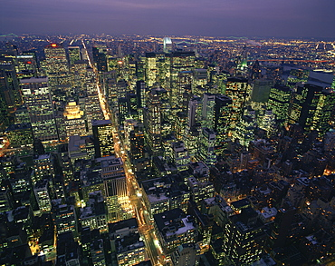 Aerial view at night of the city lights taken from the Empire State building and looking up Fifth Avenue, New York, United States of America, North America