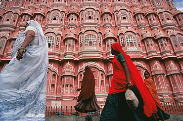 Women in saris walking past the Palace of the Winds (Hawa Mahal), Jaipur, Rajasthan state, India, Asia