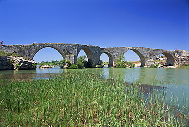 Arches of the Seljuk bridge over the Eurymedon River near Aspendos in the Antalya area of Anatolia, Turkey, Asia Minor, Eurasia