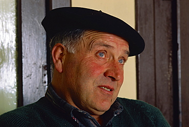 Portrait of Victor Harriet wearing a black beret, a man who still makes ewes milk cheese called Brebis, in the Basque area, Aquitaine, France, Europe