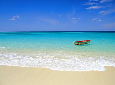 Boat moored near beach, Caribbean Sea, West Indies