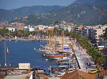 Gulets in the harbour with the town and hills in the background, at Marmaris, Anatolia, Turkey, Asia Minor, Eurasia