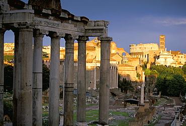 View across Roman Forum towards Colosseum and St. Francesca Romana, Rome, Lazio, Italy, Europe